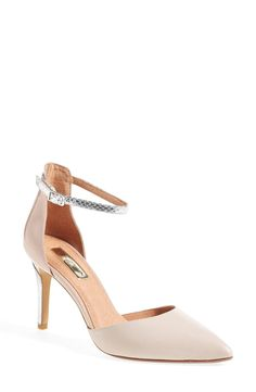 This sophisticated pointy-toe sandal with a slender ankle strap is true a modern standout.