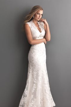 Searching for a wedding dress that you'll still love 25 years from now? Your wish is our command: Try this lace fit-and-flare style with a scalloped neckline, crystal-beaded waist and keyhole back. Gown, about $999, by Allure Bridals.Check out more gorgeous dresses in our Allure Bridals gown gallery!Photo courtesy of designer
