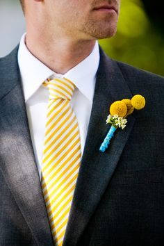 The groom and his groomsmen wore ashen suits with yellow-and-white striped ties and bright boutonnieres fashioned out of three yellow billy balls tied with turquoise ribbon. #groomfashion Photography: Kenzie Shores Photography. Read More: http://www.insideweddings.com/weddings/sentimental-southern-wedding-with-yellow-decor/452/
