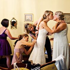 Nothing calms wedding day butterflies like a quick kiss. Photo by Katie Stoops Photography.