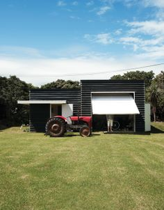 """The site includes a boat shed and a tractor the family uses to pull their boat to and from the ramp. Tagged: Garage and Detached Garage Room Type. Search """"shed"""" from Bach to the Beach. Browse inspirational photos of modern garages. Modern Shed, Modern Garage, Utility Sheds, Boat Shed, Outdoor Sheds, Shed Plans, The Fresh, House Tours, Outdoor Living"""