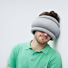 A travel pillow that really pulls its weight.  It doubles as an eye mask, triples as neck support and quadruples as a human interaction deterrent.