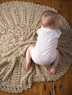 Simply beautiful heirloom baby blanket to knit.  The circular shape gives a unique shape to this 5-star reviewed baby blanket. It's also knit with chunky-weight yarn and larger needles for a faster project. | Baby Blanket Knitting Patterns, many free at http://intheloopknitting.com/baby-blanket-knitting-patterns/