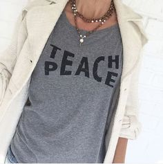 TEACH PEACE You will love this effortlessly cool and easy tee shirt. We hand screen this tee with hand mixed BLACK water based ink onto HEATHERED GREY tri-blend jersey. This is a lightweight, breezy t                                                                                                                                                     More