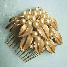 Pearl Cluster with Gold Leaves Hair Comb. $96.00, via Etsy.
