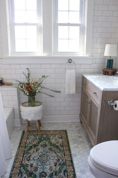 The big reveal is here! Our journey began seven weeks ago with a bathroom that was in need of some major love. To quote my Week 1 s...