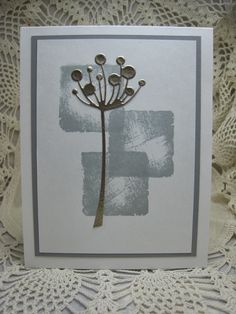 handmade card created by bjk ... silver die cut fantasy flower ... three overlapping stamped blocks in gray ... luv the balance and simplicity ...