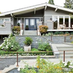 Pearl Gray and Slate Blue add eye-catching color to this home's facade!
