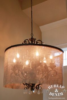 Take an old light fixture & paint it black, then create a burlap drape for it...