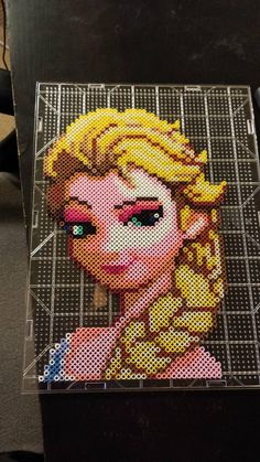 Dude, this is incredible! It's Elsa made out of those melt beads (I don't know what they're called...)