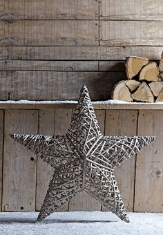 Made from willow shaped around a metal frame, our oversized star is a frosty shade of grey that will work with any number of Christmas décor schemes. Display indoors for a natural woodland feel, or use to add a subtle festive touch to your garden or porch.