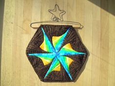 This is the Twisted Log Cabin pattern.  I only wanted to do one hexagon, but some of the large projects are stunning!
