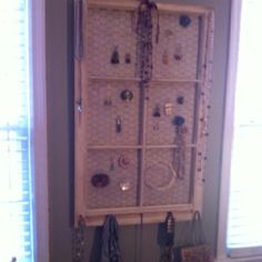 Jewelry holder from an old window frame and left over burlap and chicken wire