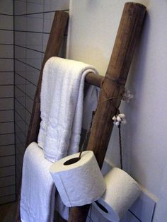 Toilet paper suspended from a loop of rope, slung over a ladder.