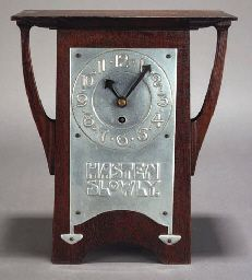 'HASTEN SLOWLY' A STAINED CEDARWOOD MANTLE CLOCK CIRCA 1900