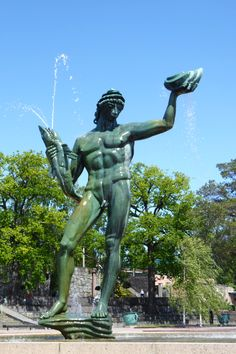 Poseidon is the god of the sea in Greek mythology. Carl Milles received a commission to create a fountain for Götaplatsen in Göteborg. Poseidon is mighty figure, seven meters tall, standing naked with steady legs on a rock. In one hand he holds a fish, in the other a shell. Poseidon appears to be part of the ocean to which he belongs. His hair is made of mussels, his hat is a shell, and his face can be described as wild and powerful In the myths, Poseidon is both temperamental and…