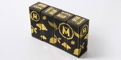 "Marou faiseur de chocolat establishes its luxury codes through this black package, which makes gold colour more intense.  Placing several ""M"" within a badge enhances this choice. I particularly like the association of four boxes creates a picture made up of golden fruits, like a reminder of paradise."