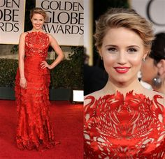 In the minority, though I may be, I think Dianna Agron looks particularly pretty in Giles Deacon laser-cut, tiered ruffles.  The bodice is so interesting, the color, extreme; it's different, and it's fun.  Young.  Bold.  Exactly what she is, and should be!