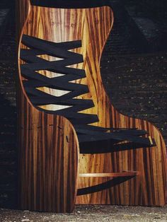art-armchair-with-wooden-figured-base-and-harnesses-for-comfortable-relaxation