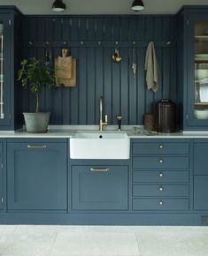 blue grey kitchen cabinetry and a farmhouse sink