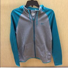 Teal and gray Nike therma-fit zip up Brand new never worn, too big for me. Fleece lined on the inside super soft and warm! Nike Jackets & Coats