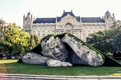 """""""Popped Up"""", a public sculpture in Budapest by Ervin Loránth Hervé of http://www.herveart.com description at link (h/t BoredPanda) """"Artist Ervin Loránth Hervé created an impressive sculpture called """"Popped Up"""" that depicts a giant man crawling out of the earth. The polystyrene sculpture is located at Széchenyi Square in Budapest, Hungary, and was one of the highlights for the Art Market Budapest 2014 international contemporary art fair."""""""