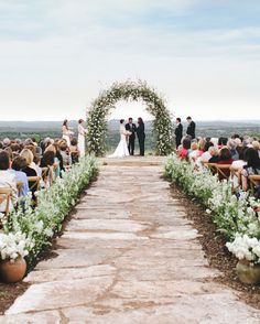 This couple made it official under a handmade arch of more than 1,500 blooming cherry and pear branches at their Texas wedding.