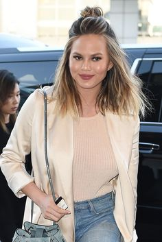 Chrissy Teigen puts a beachy skin on the half topknot.