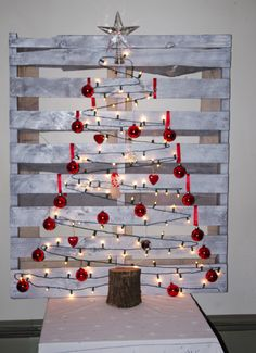 Pallet Christmas Tree 2014 --  Tired of lugging out all the ornaments? I wanted something different this year, and made this Christmas tree from found objects, lights and ornaments from the attic, and $2.00 of white spray paint.