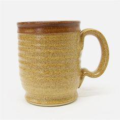 http://www.etsy.com/treasury/MTI4MDQzMTZ8MjcyMzA0Mzk0Mg/july-findsWarm Brown Pottery coffee Mug with a Brown Stripe (microwave safe). $14.00, via Etsy.