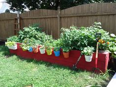 I painted my raised bed with Emperor's Silk chalk paint (ASCP) and hung IKEA planters off the side.