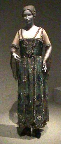 Evening Dress, 1911-13, Callot Soeurs, France; house founded 1895-closed 1937, Silk georgette bodice; metallic mesh over satin skirt; bead embroidered floating panels, gift of Mrs. Helen Crocker Russell. Front