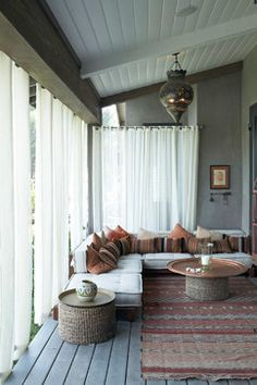 Use sheer drapes to block out bugs from our outdoor dining room.
