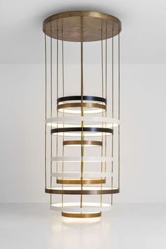 Dimore Studio - Chandelier of layered bands, multiple metal finishes: