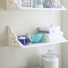 Love the idea of taking a shelf with decorative bracket and flipping it over. Looks pretty cool for a bathroom or laundry room.