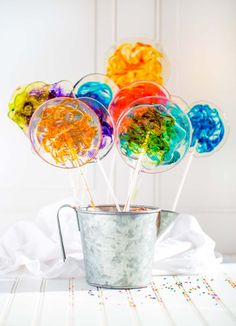 These stunning STAINED GLASS LOLLIPOPS are clear free-form lollipops with gorgeous colorful swirls. You are going to love this quick easy 30-minute recipe! Only 5 simple ingredients are needed to make this childhood party favorite. Every kid on the block will want one of these beautiful suckers on long elegant sticks. #lollipops #hardcandyrecipe #hardcandy #homemadelollipops #stainedglasslollipops #lollipoprecipe #swirllollipops #DIYlollipops #lollipop #partyrecipes #birthdayparty…
