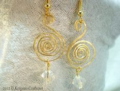 With this Hammered Spiral Wire Earring Tutorial, you will learn the simple wire jewelry techniques behind creating these stunning hammered wire earrings by following along with this video tutorial.