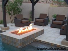 love this fireplace integrated with the pool and outdoor seating area. This would totally work in our backyard.