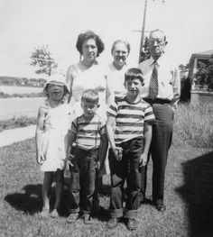 """""""This photo was taken in 1950 while our family was on a summer vacation at the Jersey Shore. I am the lovely creature on the left with a horrendous case of poison sumac and look like a creature from outer space. My two brothers seem only intent on shooting the photographer, and my mother, grandmother [...]"""