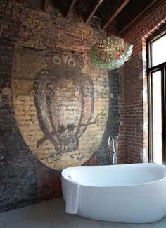 My Bohemian Home ~ Bathrooms and Powder Rooms This tub is more sleek and modern than I usually like, but in this rustic bathroom, I think it works. And I don& know about you, but that owl mural on the raw brick wall just screams & to me. Bohemian Bathroom, Deco Design, Exposed Brick, Beautiful Bathrooms, Bathroom Inspiration, My Dream Home, Interior And Exterior, Modern Interior, Mid-century Modern