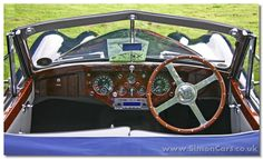k_Jaguar XK140 DHC inside - Jaguar XK140 DHC. The Drophead Coupe and Fixed Head Coupe were better equipped than the Roadster; both were given wood veneer dashboard and trim in place of the Roadster's leather finish.