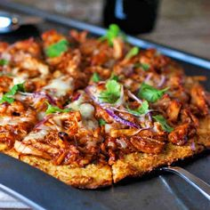 This light BBQ chicken pizza has just 150 calories per slice thanks to a cauliflower pizza crust. Healthy, colorful, and full of BBQ flavor!