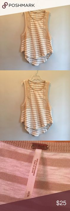 """Free People Striped Flowy Tank with Sparkle This tank is fun and boho! It has silver reflective sequins on the sides for some sparkle. There is slight unraveling on some of the silver sequins but they are not at risk of falling off and two very faint stains.  Front length: 23"""" Back length: 27"""" Arm hole to bottom: 8"""" ⭐️Same or next day shipping ⭐️Offers considered or countered ⭐️15% off a bundle of 3+ items ⭐️Additional pictures or measurements upon request ⭐️Measurements are as close to…"""