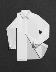 artistic flat lay of crisp white shirt by scheltens & abbenes — explore our parcels of elevated essentials for minimalist design enthusiasts @ minimalism.co