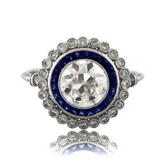 A dynamic Art Deco Styled Diamond and Sapphire Engagement Ring set in Platinum.
