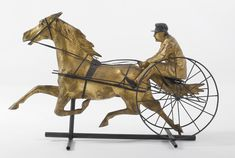 AN AMERICAN PAINTED AND PARCEL-GILT MOLDED COPPER HORSE AND SULKY WEATHERVANE  CIRCA 1880, PROBABLY FISKE AND CO.