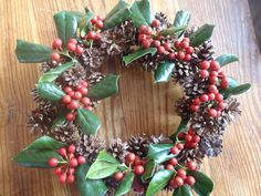 This Christmas wreath is made by attaching scotch pinecones to a wild rose wreath, with sprigs of holly for colour. All natural except a bit of wire used to attached the cones.