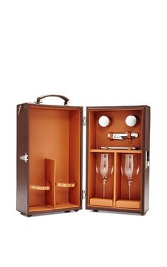 Pigskin Traveling Wine Box, $2,900 (for more extravagant holiday gifts -- http://chicityfashion.com/extravangant-gifts/)