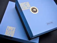 "Index 34 Design Studio has rebranded Brownerie. The gourmet bakeshop is all about taking a childhood favorite and reintroducing it with sophisticated packaging. A matte paper box was soaked in an intense sky blue and grounded with a chocolate brown; while a gold verse plummets off the edge and is finished with a shiny gold sticker. A bitten brownie is iced with the letter ""B,"" and those very bite marks were cut into the description card inside as a playful gesture ."