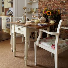 Country dining room with brick feature wall I would use stone, being in Bulgaria. Cream Dining Room, Cosy Dining Room, Country Dining Rooms, Living Room Sofa, Country Kitchens, Country Living, Living Rooms, Dining Table, Brick Feature Wall